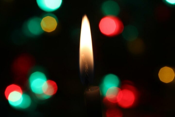 Christmas candle with bokeh effect